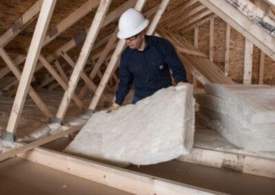 Austin Company   installation of white fiberglass in residential attic