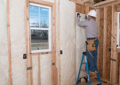 Austin Company | residential home installation of white fiberglass insulation