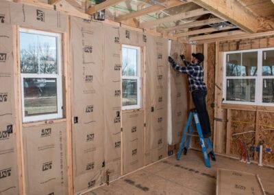 Austin Company   installing fiberglass in home